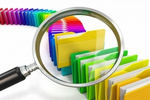 file folders with magnifying glass