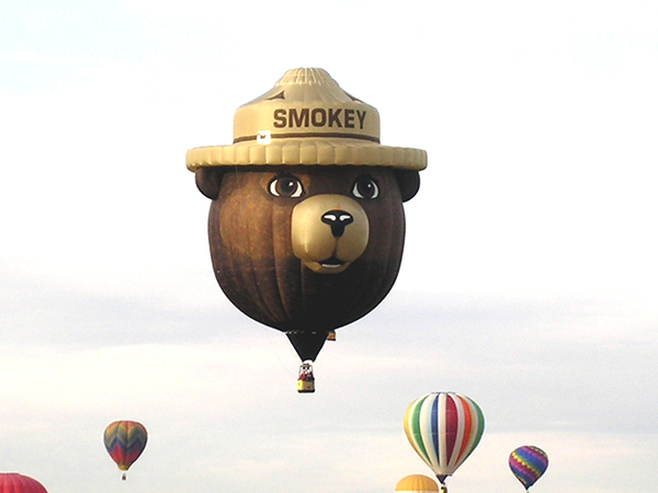 The Smokey Bear Hot Air Balloon is considered a 'special shape' balloon and draws fans in from miles away. The balloon is 55' in diameter and nearly 100' tall.