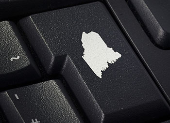 Black keyboard detail with imprint of Maine on enter key