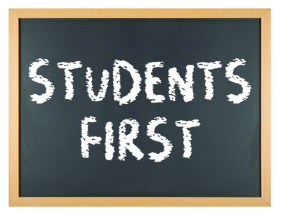 Students First written on a chalkboard
