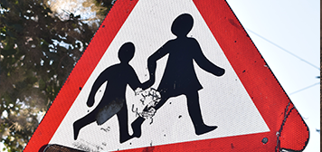 kids crossing sign