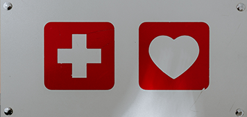 red health cross and a red heart