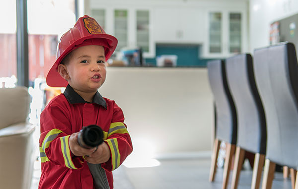Photo of young boy dressed as a firefighter
