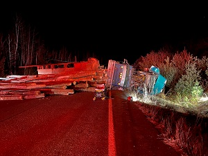 Logging truck rollover on Route 9 in Clifton