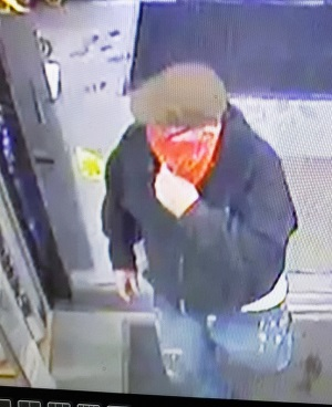 Unidentified suspect wearing red banadana