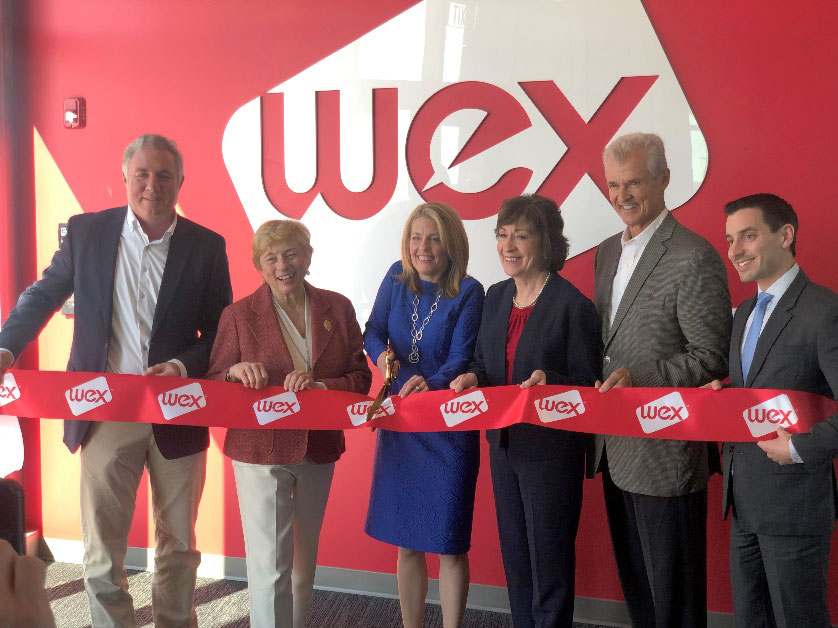 Governor Mills cutting the ribbon at a WEX opening