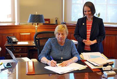 Governor Mills and Senator Shenna Bellows at signing of LD 946