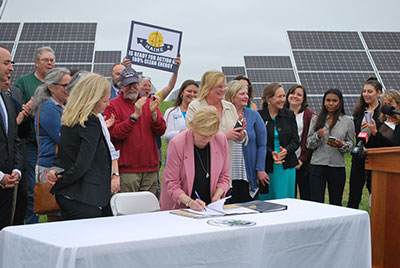 Mills signing energy and climate change bills