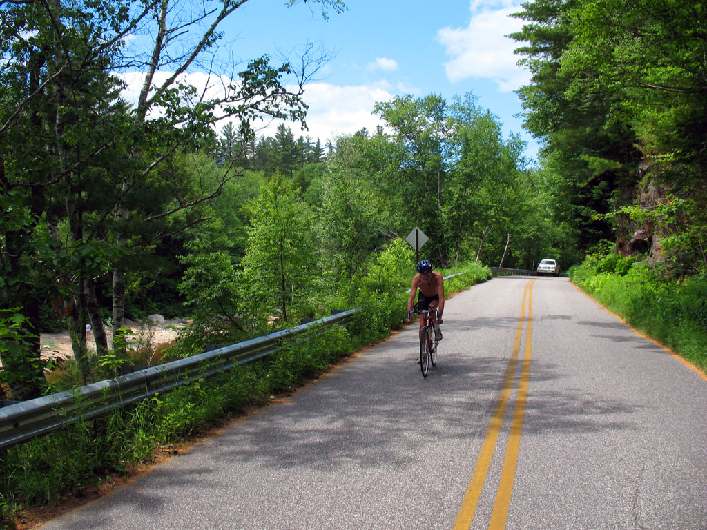 Bicyclist on Narrow Road