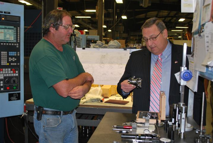 In the Shop: David Gay, a 25 year employee at Kennebec Technologies shows Governor LePage the component he made.