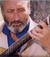 Noel Paul Stookey playing the guitar